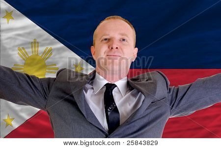 Happy Businessman Because Of Profitable Investment In Phillipines Standing Near Flag