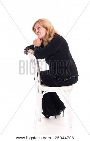 Cute Elderly Woman At Chair