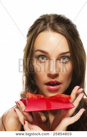 beautiful woman with wide open eyes holding red present