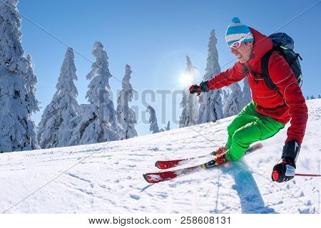 Skier Skiing Downhill In High