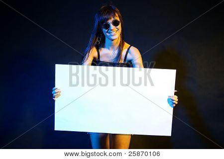Rocker style girl with blank banner.