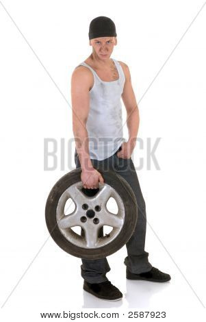 Car Repairman With Wheel