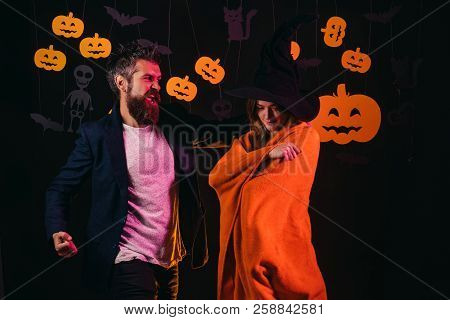 Halloween Family In Costumes On