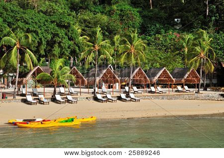 Luxury Beach with Huts and Kayaks