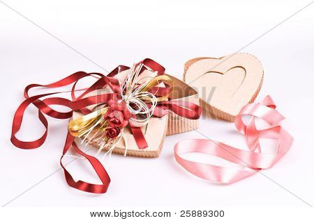 Two Isolated Heart-Shaped Open Gift Boxes With Shiny Pink And Red Silk Ribbons Composition Isolated On White Background