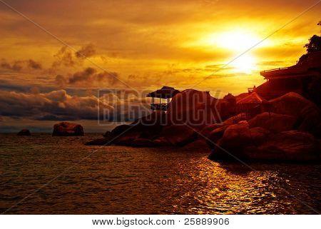 Sunset Villa Standing in Rocks on the Sea Edge