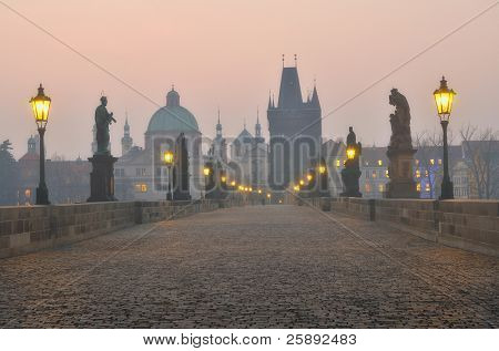 Charles Bridge in Prague during the sunrise, Bohemia, Czech Republic.