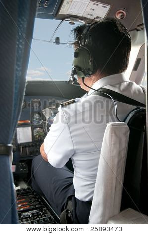 Pilot in a small plane cockpit preparing for Take-off
