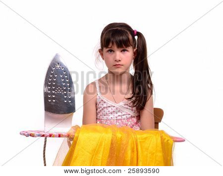 Dangerous housework - little girl with ironing board and iron isolated on white background