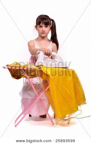 Dangerous housework - little girl ironing her dress, isolated