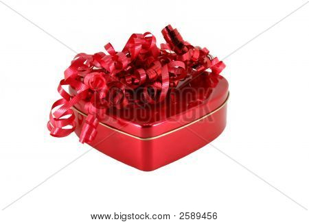 Heart Shaped Box And Curly Red Ribbon