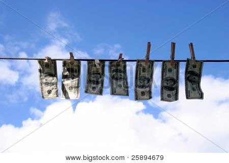 Hundred dollar bills hanging on a rope.