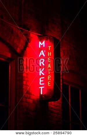 market theater neon sign taken in time laps (bulb exposure) for maximum effect