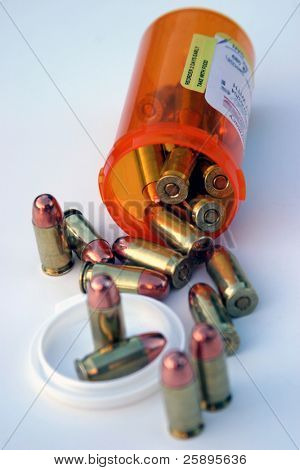 .45 cal bullets comming out of a medicine bottle on a white background