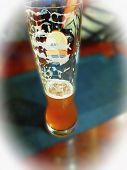 Beer Glass On A Blurred Background With Vignetting poster
