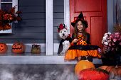 Young Funny Girl Child Kid In Halloween Orange Costume Playing Outdoor With Spooky Jack Pumpkins Wit poster