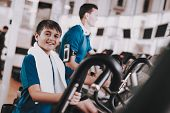 Young Father And Son Training On Treadmills In Gym. Healthy Lifestyle Concept. Sport And Training Co poster