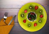 Dessert Cake With Kiwi And Strawberries On A Wooden Background. Festive Dessert On A Plate Top View poster