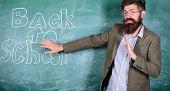 Disgusting School. Teacher Dislike Schooling. Teacher Or Educator Stands Near Chalkboard With Inscri poster