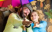Hipster With Beard And Cheerful Girl Expect Rainy Weather Hold Colorful Umbrella. Rainy Weather Not  poster