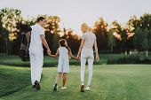 Happy Young Family Relax On Golf Field In Summer. Relaxing In Golf Club. Sports In Summer. Outdoor F poster