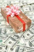 stock photo of prank  - Red Brick Gift and dollars Concept of joke make fun of somebody gift on April Fool - JPG