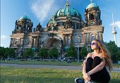 Thoughtful Girl Tourist Sitting In Germany Near Berlin Cathedral. Berlin Cathedral View In Germany W poster