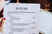 Woman Holding Resume Application With Using Tablet Digital To Job Search On Internet. Applying For A poster