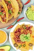An Overhead Photo Of Mexican Tacos And Nachos With Chili Con Carne And Guacamole poster