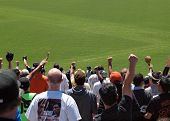 Giants Fans Raise Hands Into The Air To Cheer