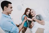 Man And Young Girl In Hospital And Happy Man. Young Man In Hospital With Young Girl. Health Girl And poster