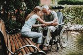 Old Man And Young Girl. Old Man And Woman. Wheelchair And Old Man On Nature. Wheelchair And Elderly  poster