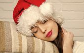 Christmas Woman Sleep At Midnight. Santa Claus Girl In Red Hat. Holiday And Celebration. Xmas And Pa poster