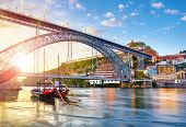 Porto old town, Portugal. Evening sunset with sunshine. Panoramic view at Ponte de Dom Luis on Douro poster