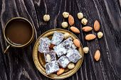 Oriental Arabian Sweets With Different Nuts A Cup Of Coffee. Eastern Sweets. Traditional Turkish Del poster