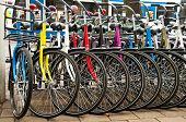stock photo of mountain chain  - Row of parked colorful bicycles - JPG