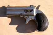 stock photo of derringer pistol  - an antique 2 shot  - JPG