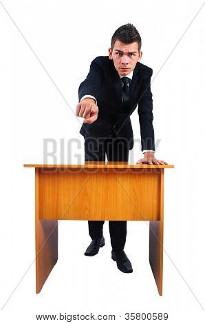 Isolated business man pointing at desk