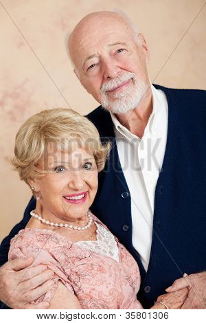 Vertical orientation portrait of a beautiful senior couple in their eighties.