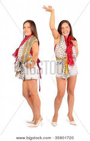 Two same happy women wearing in shorts dance in studio on white background.