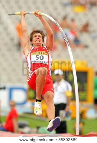 BARCELONA - JULY 10: Lukas Wirth of Austria during Pole Vault event of the 20th World Junior Athletics Championships at the Olympic Stadium on July 10, 2012 in Barcelona, Spain