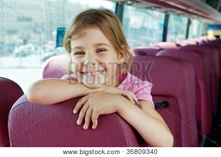 Closeup portrait of smiling girl on bus seat