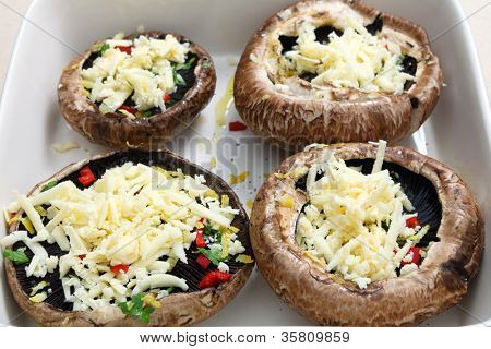Portobello mushrooms, stuffed with chopped parsley, red chilli,lemon peel and grated cheese, ready for the oven