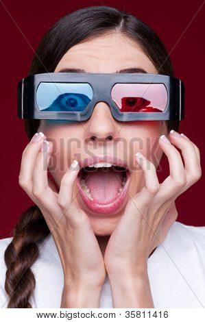 emotional young woman watching 3d film and screaming
