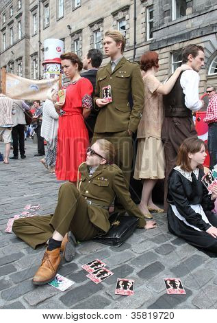 EDINBURGH- AUGUST 11: Members of Greenwich Theatre publicize their show Macbeth during Edinburgh Fringe Festival on August 11, 2012 in Edinburgh