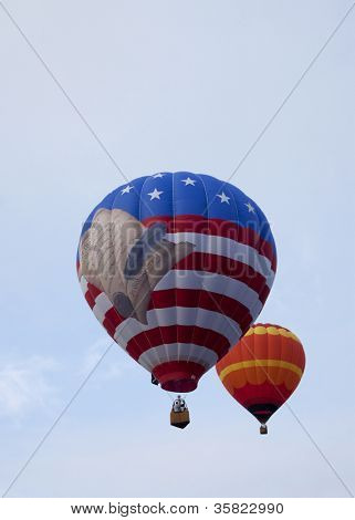 READINGTON, NJ-JUL 29: The patriotic Freedom Flyer hot air balloon ascends up into the sky at the Quick Chek New Jersey Festival of Ballooning on the morning of July 29, 2012 in Readington, NJ.