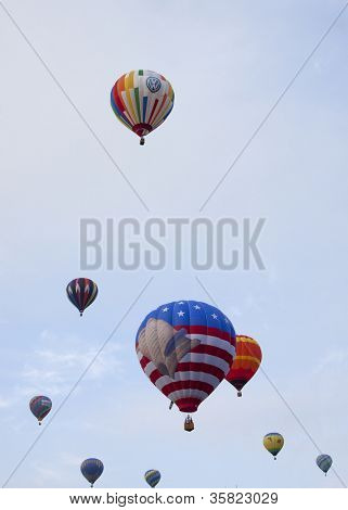 READINGTON, NJ-JUL 29: An array of hot air balloons including the patriotic Freedom Flyer ascend into the sky at the Quick Chek New Jersey Festival of Ballooning on July 29, 2012 in Readington, NJ.
