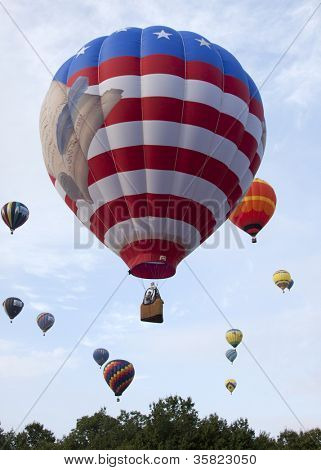 READINGTON, NJ-JUL 29:The patriotic Freedom Flyer is among an array of hot air balloons that ascend into the sky at the Quick Chek New Jersey Festival of Ballooning on July 29, 2012 in Readington, NJ.