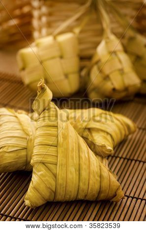 Traditional Asian Malay food, ketupat or packed rice in low light setting