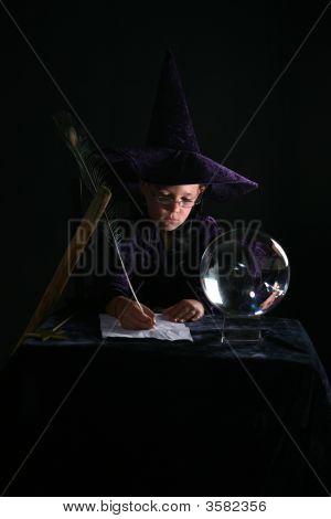Wizard Boy Writing A Spell